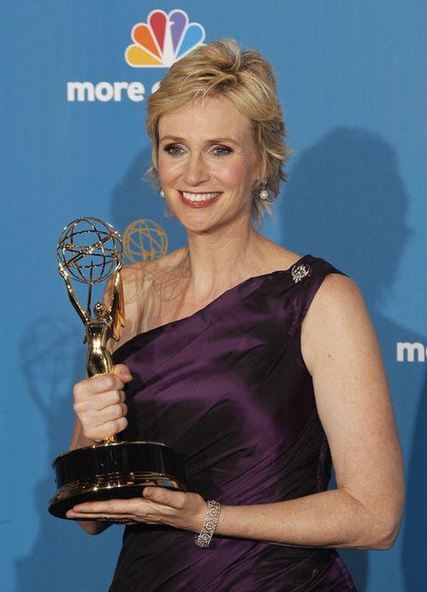 Arm, Dress, Hand, Logo, Electric blue, Trophy, Award, Blond, Cobalt blue, Day dress,