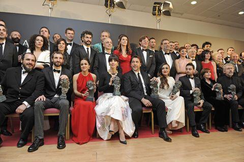 Footwear, Suit trousers, Suit, Formal wear, Tie, Blazer, Team, Audience, Employment, Management,