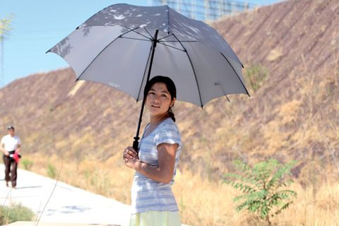 Human, Skin, Sleeve, Human body, Photograph, Leisure, Umbrella, Beauty, Travel, Temple,