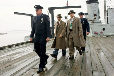 Military uniform, Team, Military person, Deck, Crew, Wood flooring, Naval architecture, Ship, Boardwalk, Flag,