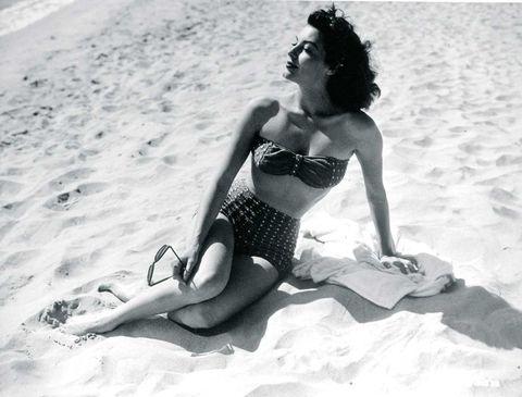 Human body, Brassiere, Photograph, Human leg, Sunglasses, Summer, Sitting, Sand, Elbow, Black hair,
