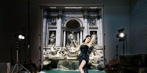 Dress, Waist, Beauty, Model, Fashion model, Stage, Light fixture, Photography, Flash photography, Lamp,