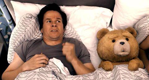 Comfort, Toy, Teddy bear, Stuffed toy, Bear, Linens, Sitting, Black hair, Plush, Bedding,