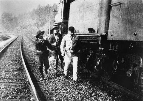Transport, Track, Standing, Railway, Rolling stock, Pebble, Rubble, Train, Railroad car, Crew,