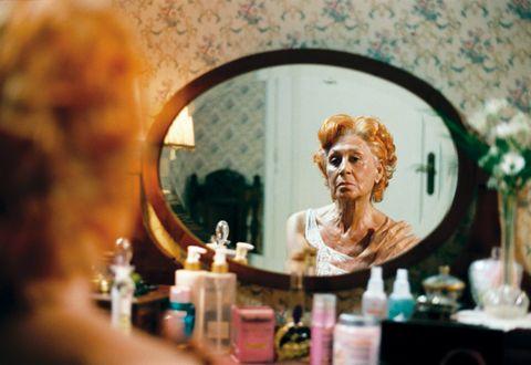 Reflection, Mirror, Eyelash, Bottle, Transparent material, Peach, Makeover, Hair care, Makeup mirror, Cosmetics,