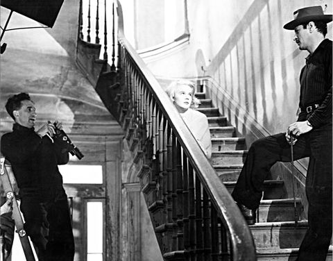 Stairs, Handrail, Hat, Baluster, Monochrome, Fedora, Umbrella, Sun hat, Costume hat, Flag,