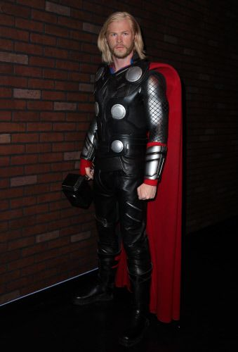 Latex, Boot, Leather, Costume, Latex clothing, Leather jacket, Fictional character, Brick, Riding boot, Dry suit,