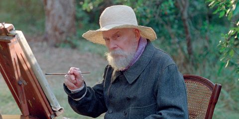 Wood, Hat, Facial hair, Sitting, Headgear, Wood stain, Sun hat, Outdoor furniture, Beard, Wrinkle,