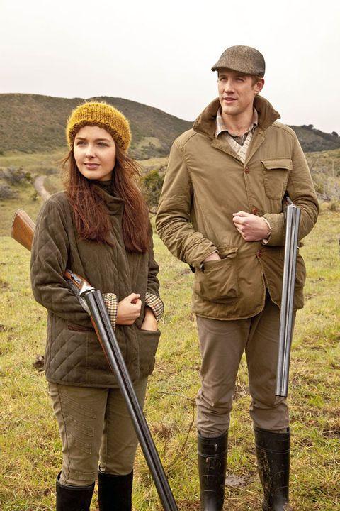 Mammal, Cap, Khaki, People in nature, Headgear, Boot, Beanie, Riding boot, Walking stick, Knit cap,