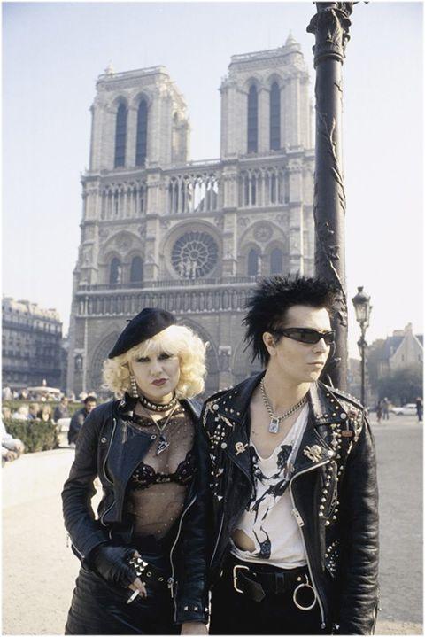 Outerwear, Sunglasses, Fashion accessory, Style, Hat, Jacket, Street fashion, Jewellery, Landmark, Necklace,