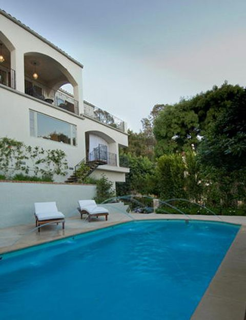 Swimming pool, Property, Real estate, Resort, House, Outdoor furniture, Residential area, Home, Azure, Villa,