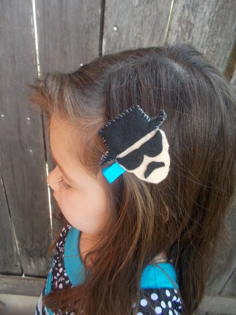 Hair, Hairstyle, Style, Earrings, Hair accessory, Turquoise, Teal, Long hair, Polka dot, Hair tie,