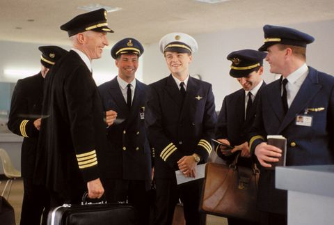 Collar, Hat, Suit trousers, Uniform, Dress shirt, Formal wear, Cap, Headgear, Team, Blazer,