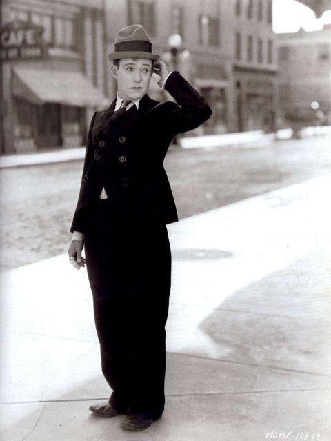 Sleeve, Collar, Photograph, Standing, Hat, Style, Street fashion, Formal wear, Monochrome, Blazer,