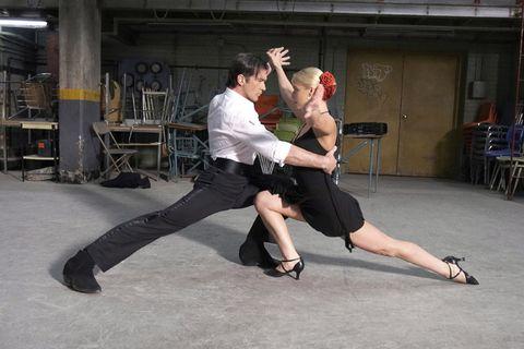 Event, Human leg, Entertainment, Performing arts, Interaction, Dance, Performance art, Contact sport, Dancer, Calf,