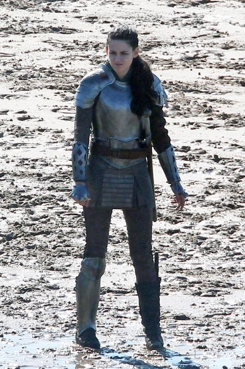 Standing, Boot, Armour, Costume, Costume accessory, Costume design, Belt, Glove, Leather,