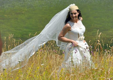 Clothing, Bridal veil, Veil, Dress, Bridal clothing, Happy, Wedding dress, Bride, Bridal accessory, People in nature,