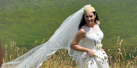 Clothing, Bridal veil, Veil, Dress, Bridal clothing, Happy, Wedding dress, Bride, Bridal accessory, People in nature,