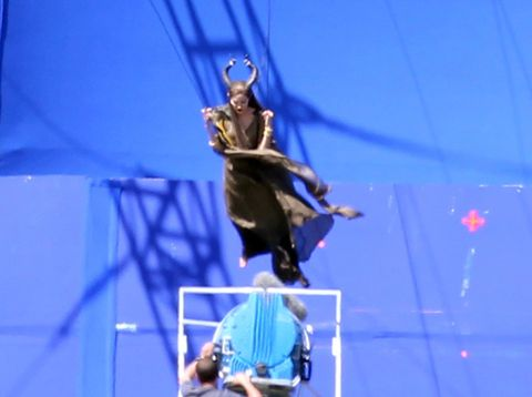 Performing arts, Entertainment, Performance, Electric blue, Stage, Public event, Performance art, Circus, Talent show, Balance,