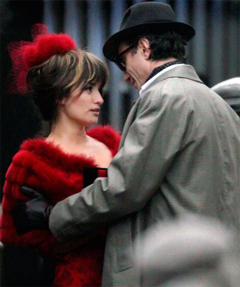 Hat, Coat, Outerwear, Style, Interaction, Headgear, Costume accessory, Fashion, Fur, Sun hat,
