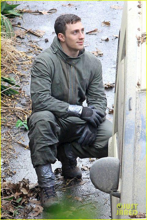 Human body, Jacket, Shoe, Sitting, Boot, Street fashion, Crew cut, Buzz cut, Leather, Motorcycle boot,
