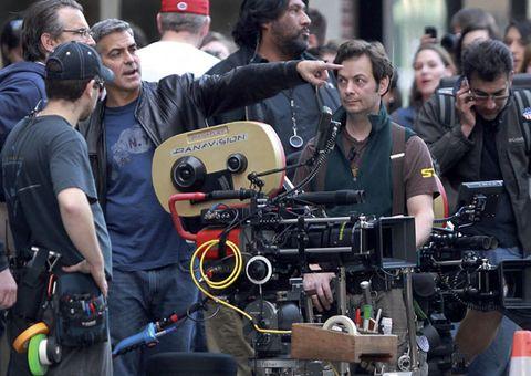 Video camera, Cameras & optics, Cap, Filmmaking, Television crew, Camera operator, Film crew, Baseball cap, Videographer, Cinematographer,