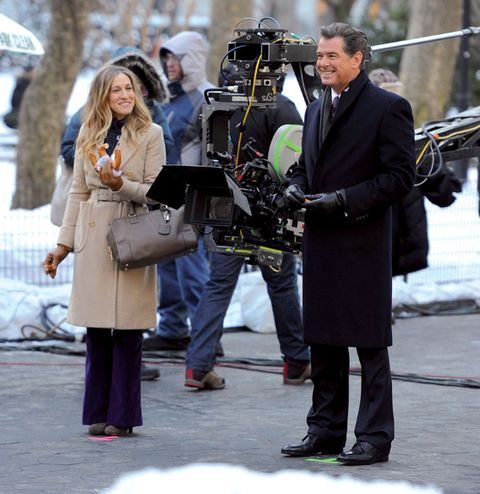 Winter, Trousers, Coat, Outerwear, Video camera, Camera, Street fashion, Videographer, Television crew, Filmmaking,