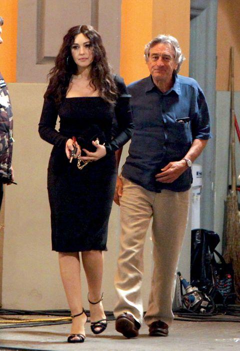 Trousers, Dress, Shirt, Outerwear, Standing, Formal wear, Waist, One-piece garment, Fashion, Little black dress,