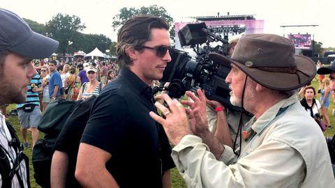 Camera, Hat, Mammal, Video camera, Videographer, Television crew, Camera operator, Crowd, Cameras & optics, Sunglasses,