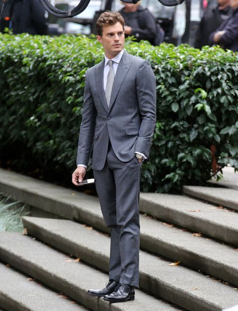 Clothing, Coat, Dress shirt, Collar, Trousers, Shirt, Stairs, Standing, Outerwear, Suit,