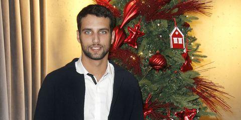 Sleeve, Dress shirt, Textile, Red, Christmas decoration, Standing, Collar, Facial hair, Interior design, Holiday,