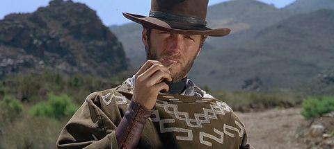 Hat, Mountainous landforms, Facial hair, Hill, Highland, Sun hat, Headgear, Soldier, Fashion accessory, Mountain range,