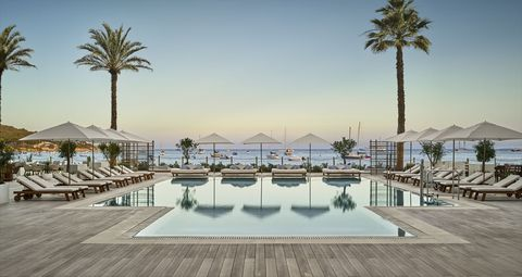 Swimming pool, Resort, Property, Palm tree, Tree, Building, Architecture, Hotel, Vacation, Reflecting pool,