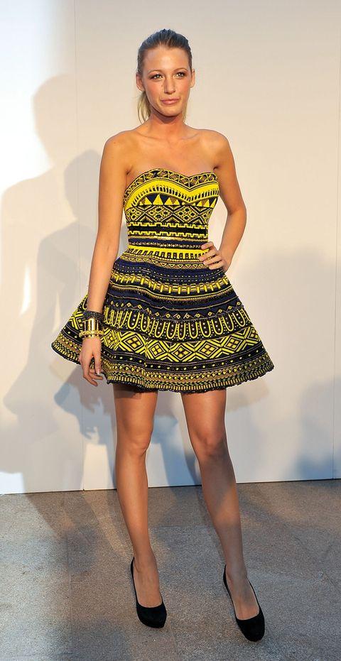 Footwear, Leg, Dress, Human leg, Shoulder, Joint, Standing, One-piece garment, Style, Strapless dress,
