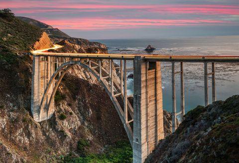 Bridge, Coastal and oceanic landforms, Rock, Coast, Formation, Sunset, Headland, Dusk, Nonbuilding structure, Evening,