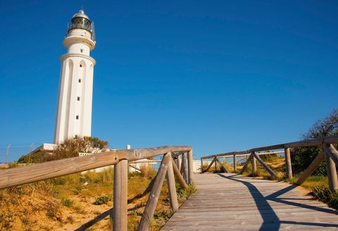 Lighthouse, Tower, Sky, Landmark, Observation tower, Sea, Walkway, Architecture, Shore, Coast,
