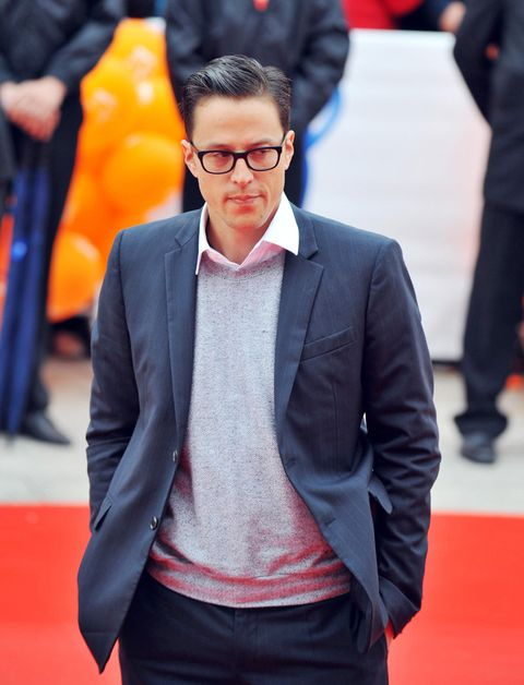 Glasses, Coat, Dress shirt, Collar, Sleeve, Trousers, Shirt, Textile, Red, Standing,