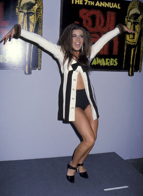 Human leg, Knee, Thigh, Calf, Long hair, High heels, Sandal, Foot, Costume, One-piece garment,