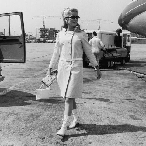 Eyewear, Airplane, Style, Automotive mirror, Sunglasses, Aircraft, Monochrome, Street fashion, Goggles, Bag,
