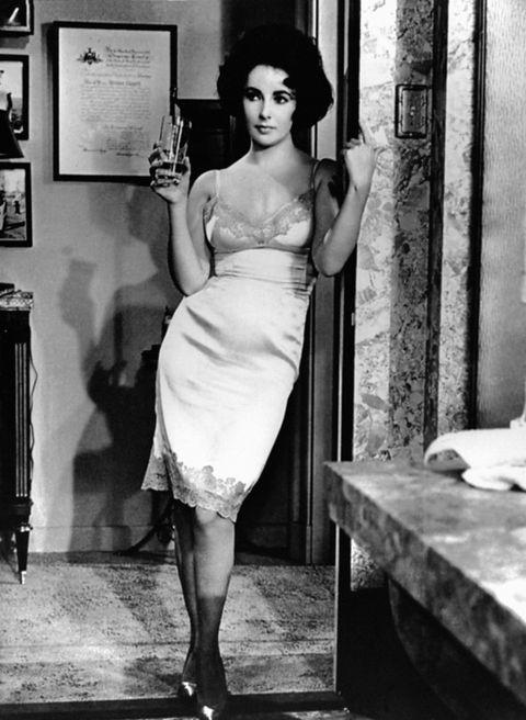 Dress, Shoulder, Human leg, Photograph, Joint, Standing, Style, One-piece garment, Waist, Day dress,