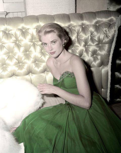 Clothing, Hairstyle, Green, Shoulder, Dress, Textile, Strapless dress, Style, Formal wear, Couch,