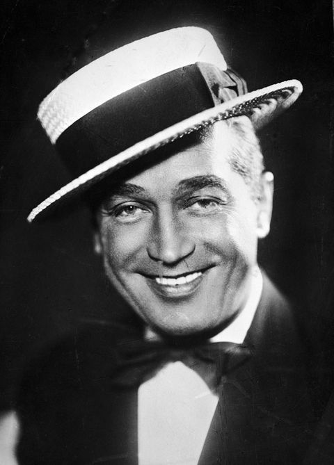 Smile, Hat, Chin, Eyebrow, Collar, Outerwear, Formal wear, Facial expression, Style, Headgear,