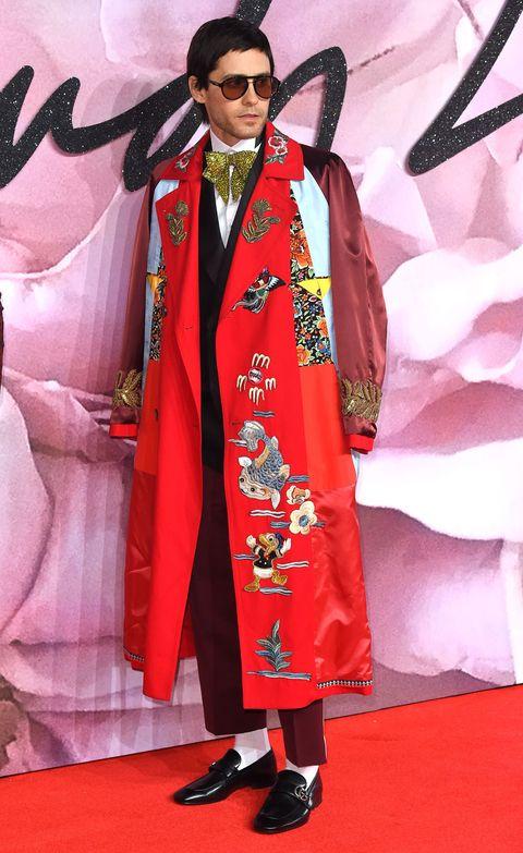 Shoe, Sunglasses, Flooring, Fashion, Carpet, Goggles, Costume, Costume design, Fashion design, Stage,