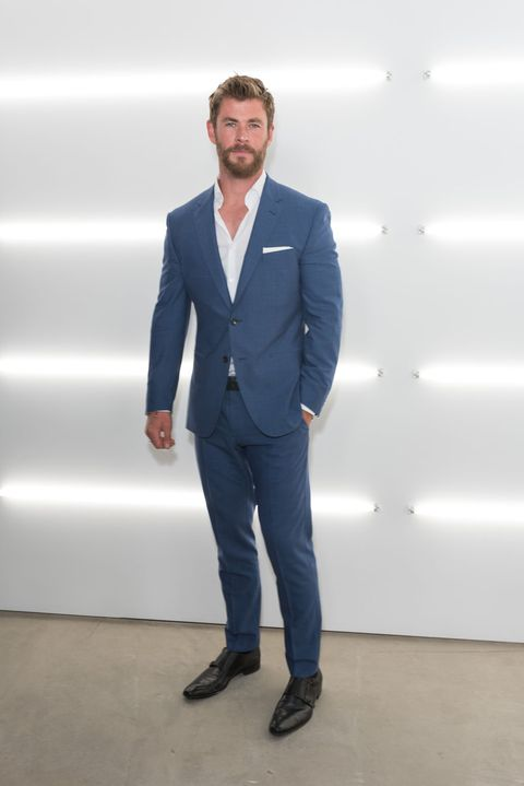 Suit, Clothing, Blue, Formal wear, Standing, Blazer, White-collar worker, Outerwear, Pantsuit, Fashion,