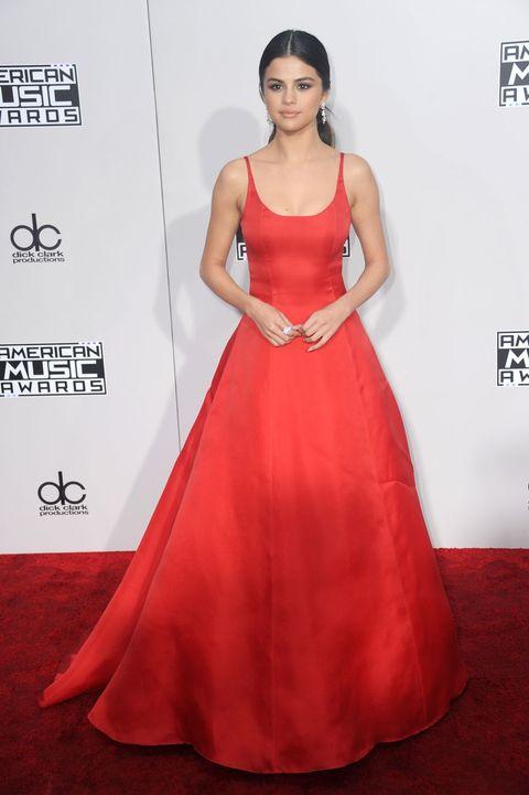 Red carpet, Dress, Gown, Clothing, Carpet, Fashion model, Shoulder, A-line, Flooring, Red,