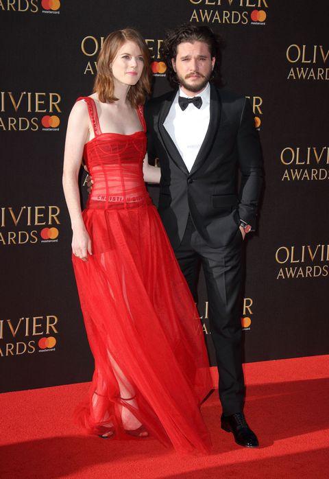Carpet, Red carpet, Clothing, Suit, Formal wear, Dress, Red, Premiere, Tuxedo, Shoulder,