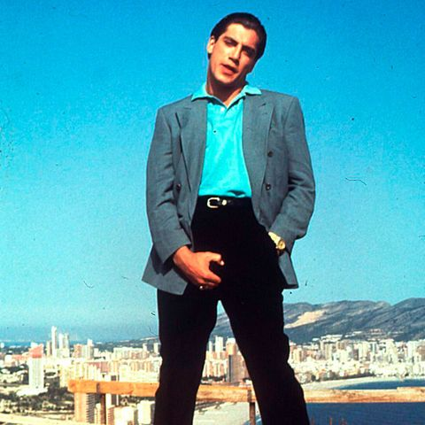 Collar, Sleeve, Dress shirt, Trousers, Coat, Human body, Suit trousers, Shirt, Outerwear, Standing,