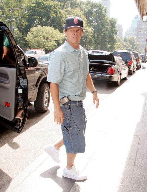 Tire, Wheel, Land vehicle, Cap, Denim, T-shirt, Fender, Asphalt, Street fashion, Hat,