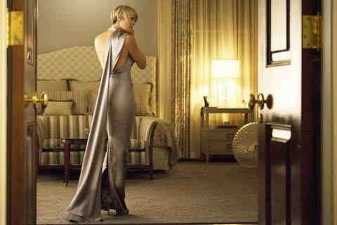 Lighting, Interior design, Fixture, Lamp, Gown, Interior design, Blond, Window treatment, Window covering, One-piece garment,