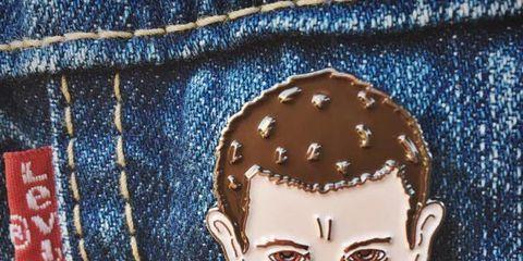 Cheek, Brown, Denim, Textile, Electric blue, Pocket, Paint, Button, Stitch, Painting,